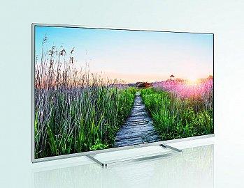 Design je přiměřeně elegantní, uzounké rámečky a páskovina podstavce napomáhají kýženému dojmu lehkosti. Vše je kvalitně zpracováno a televizor na podstavci klidně můžete položit i na drahý nábytek..