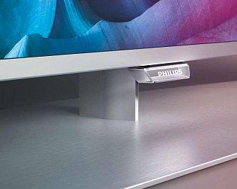 Hezký detail nohy, kovového podstavce a části s logem Philips, které se po zapnutí rozsvítí. Světlo se ale dá utlumit, či zcela vypnout.