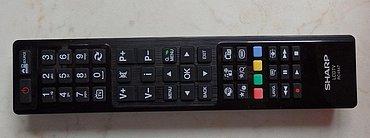 Dálkový ovladač je elegantní a kvalitní, rozložení výtečné a velice dobrá je i čitelnost tlačítek.