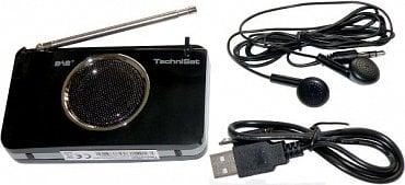 """Zadní """"reproduktorová"""" strana přijímače s příslušenstvím do kterého ještě patří manuál. Velikost přijímače si zde můžete vizuálně porovnat se sluchátky, nebo redukčním USB kabelem."""