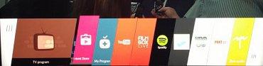 Funkce a aplikace Smart TV se zobrazují v liště ve spodní části obrazovky.