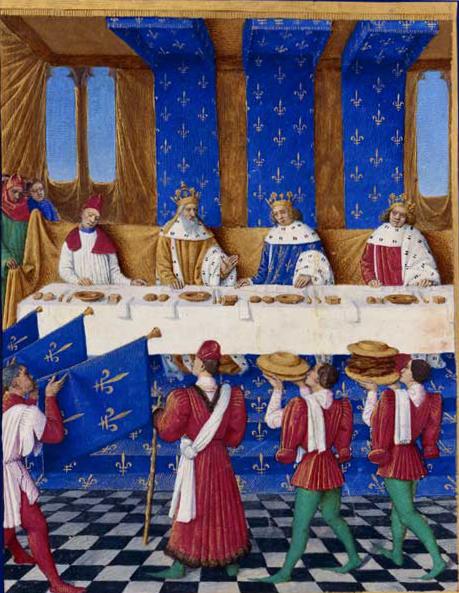 Karel IV. (vlevo) a jeho syn Václav (vpravo) na dvoře Karla V. (uprostřed) v Paříži. Každý host má dva nože, sůl, chléb, ubrousek a talíř na další pokrm.